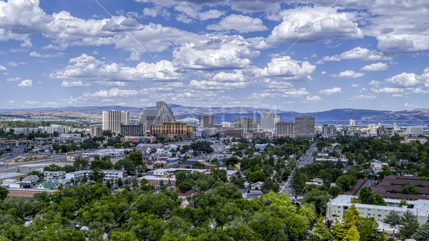 The city's skyline seen from west of the city in Reno, Nevada Aerial Stock Photos | DXP001_004_0007