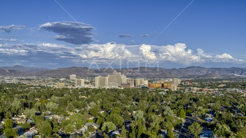 The city skyline seen from tree-lined neighborhoods in Reno, Nevada Aerial Stock Photos | DXP001_005_0004
