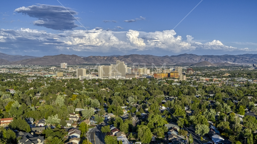 City skyline seen from tree-lined neighborhoods in Reno, Nevada Aerial Stock Photos | DXP001_005_0005