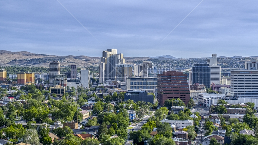 Casino resorts and office buildings seen from neighborhoods in Reno, Nevada Aerial Stock Photos | DXP001_006_0011