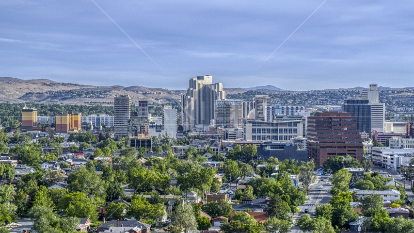 High-rise casino resorts and office buildings seen from neighborhoods in Reno, Nevada Aerial Stock Photo DXP001_006_0013 | Axiom Images