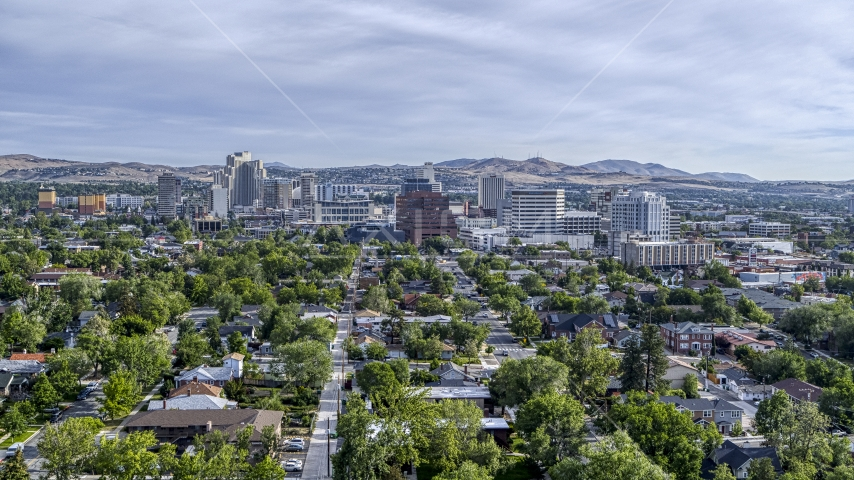 A wide view of high-rise casino resorts and office buildings seen from a neighborhood in Reno, Nevada Aerial Stock Photos | DXP001_006_0014