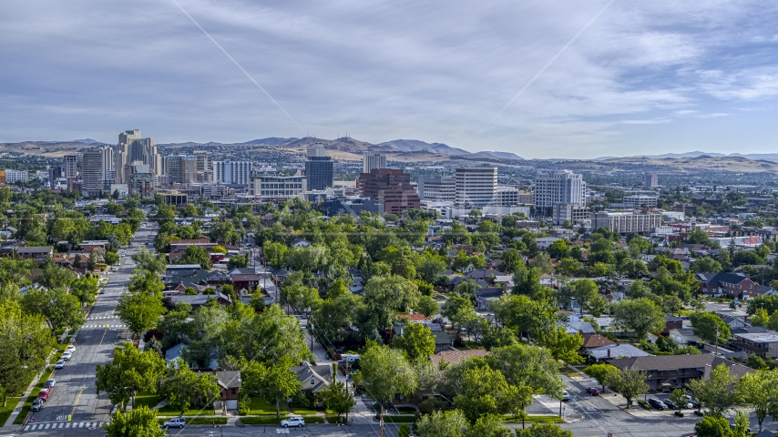 Casino resorts and office buildings seen from neighborhood with trees in Reno, Nevada Aerial Stock Photo DXP001_006_0015 | Axiom Images