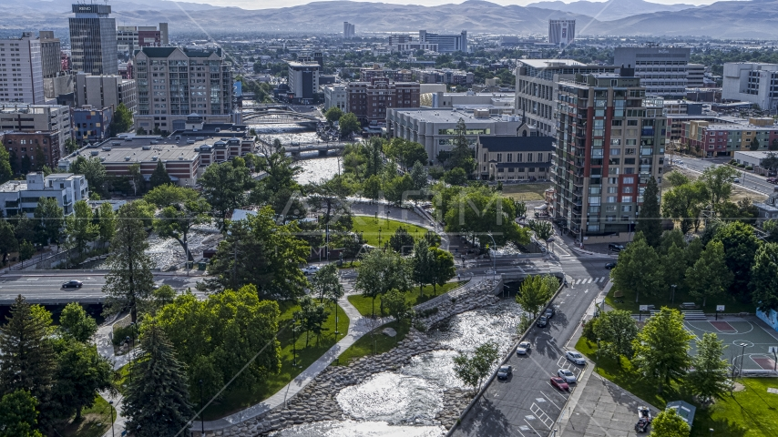 The Truckee River and Wingfield Park by office buildings in Reno, Nevada Aerial Stock Photos | DXP001_006_0017
