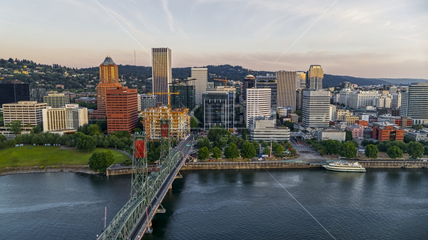 City skyline and Hawthorne Bridge spanning the Willamette River, Downtown Portland, Oregon Aerial Stock Photo DXP001_010_0003 | Axiom Images