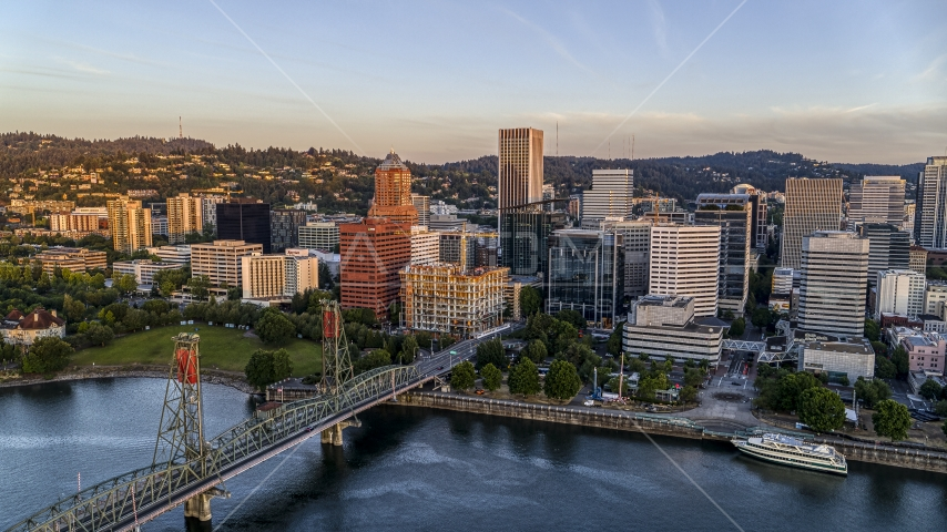 Tall skyscrapers and the Hawthorne Bridge spanning the Willamette River, Downtown Portland, Oregon Aerial Stock Photos | DXP001_010_0007