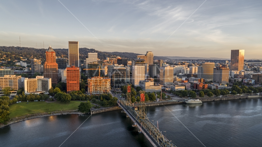 Tall skyscrapers across the Hawthorne Bridge spanning the Willamette River, Downtown Portland, Oregon Aerial Stock Photos | DXP001_010_0008