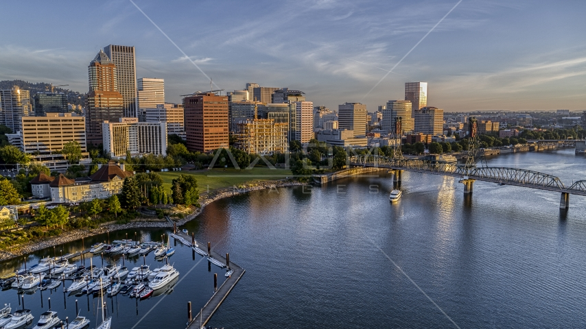 The city skyline and the Hawthorne Bridge seen from over the Willamette River, Downtown Portland, Oregon Aerial Stock Photos | DXP001_010_0011