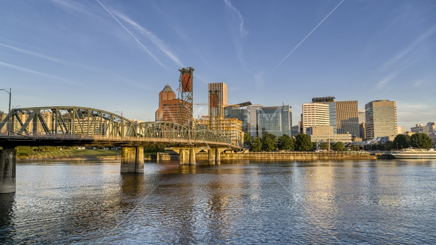 The city skyline behind the Hawthorne Bridge seen from the Willamette River, Downtown Portland, Oregon Aerial Stock Photos | DXP001_010_0012
