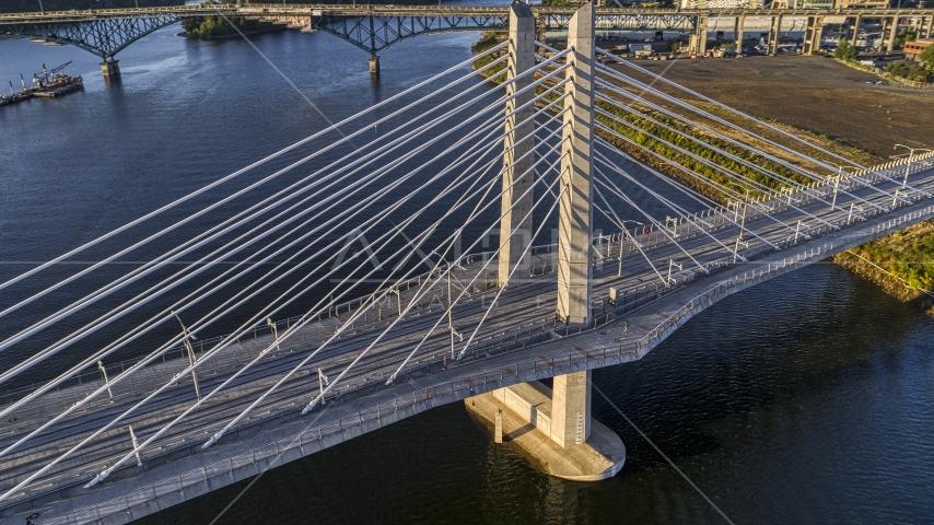 The Tilikum Crossing Bridge with no traffic spanning the Willamette River, South Portland, Oregon Aerial Stock Photos | DXP001_010_0015