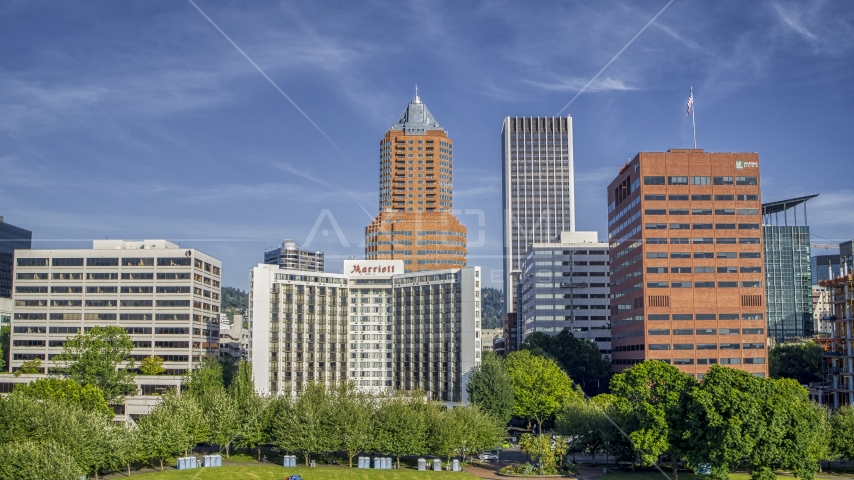 Hotel flanked by office buildings, tall skyscrapers in background, Downtown Portland, Oregon Aerial Stock Photos | DXP001_011_0008
