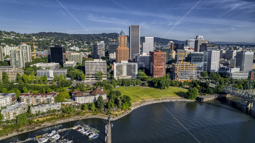 Office buildings and towering skyscrapers by the river in Downtown Portland, Oregon Aerial Stock Photos | DXP001_011_0015