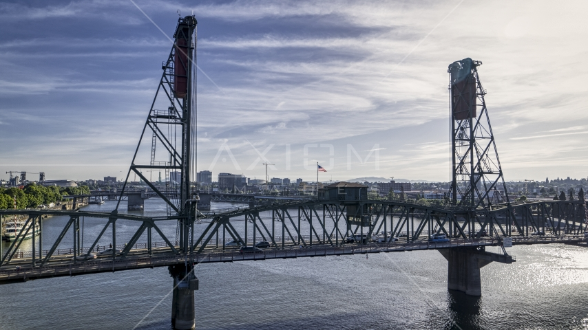 Cars crossing the Hawthorne Bridge spanning the Willamette River in Downtown Portland, Oregon Aerial Stock Photos   DXP001_011_0018