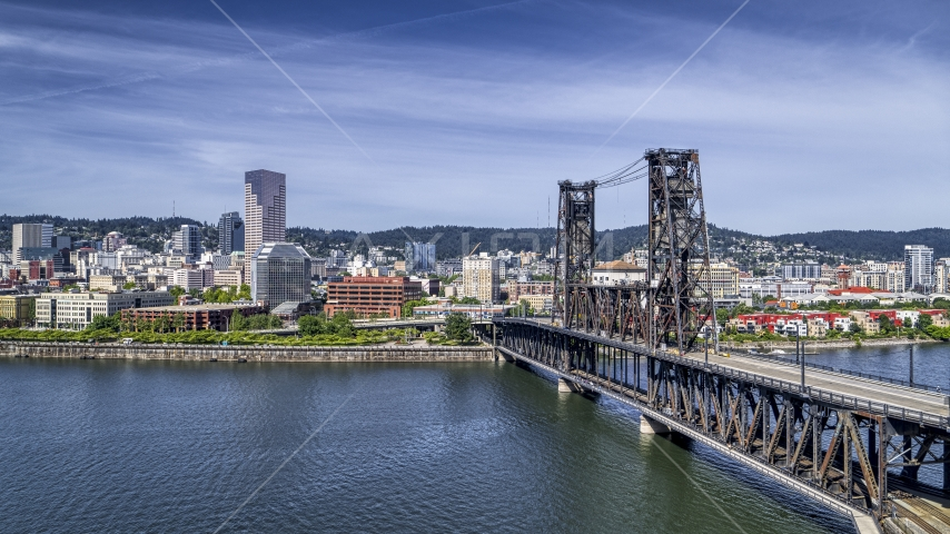 Steel Bridge and waterfront buildings in Downtown Portland, Oregon Aerial Stock Photos | DXP001_012_0001