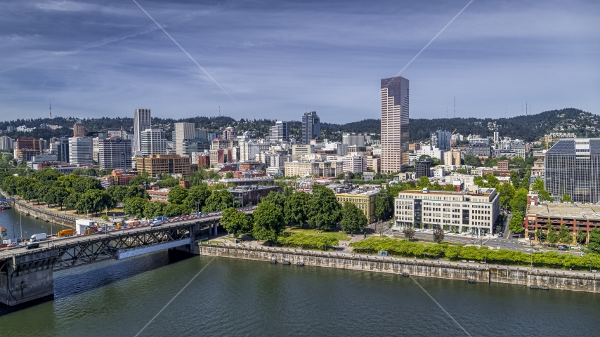 Downtown Portland seen from across the Willamette River near the Burnside Bridge, Oregon Aerial Stock Photo DXP001_012_0003 | Axiom Images