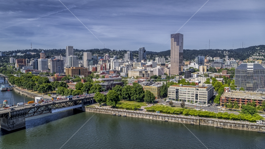 City buildings across the Willamette River in Downtown Portland, Oregon Aerial Stock Photos | DXP001_012_0004