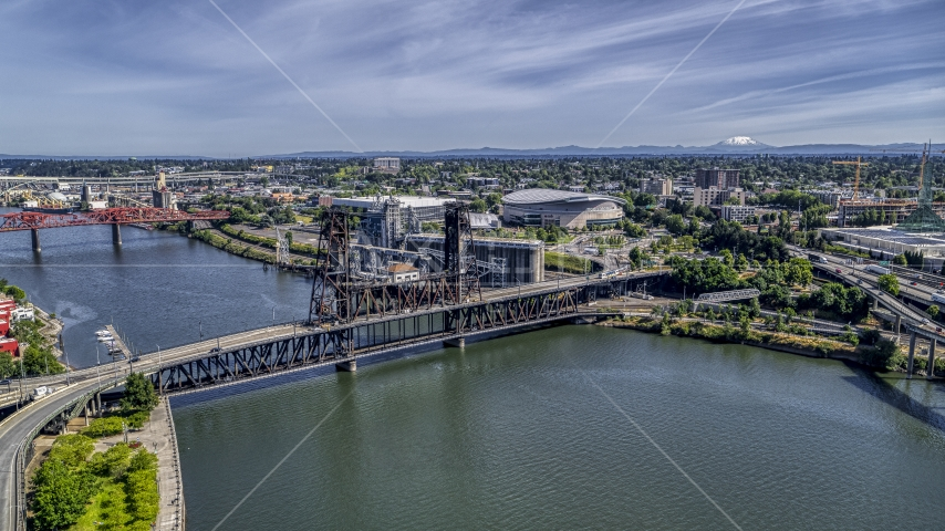 The Steel Bridge spanning the Willamette River near Moda Center arena, Northeast Portland, Oregon Aerial Stock Photo DXP001_012_0006 | Axiom Images