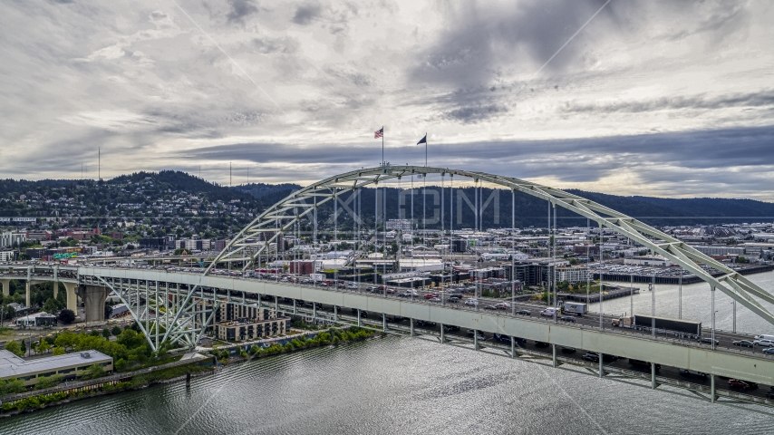 Traffic crossing the Fremont Bridge spanning the Willamette River in Downtown Portland, Oregon Aerial Stock Photos | DXP001_013_0003