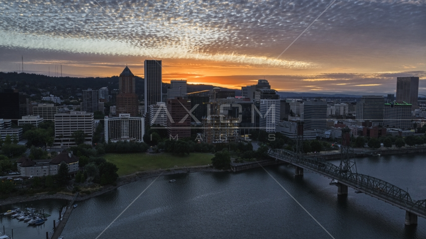 The city skyline near the Hawthorne Bridge and Willamette River at sunset in Downtown Portland, Oregon Aerial Stock Photos | DXP001_014_0009
