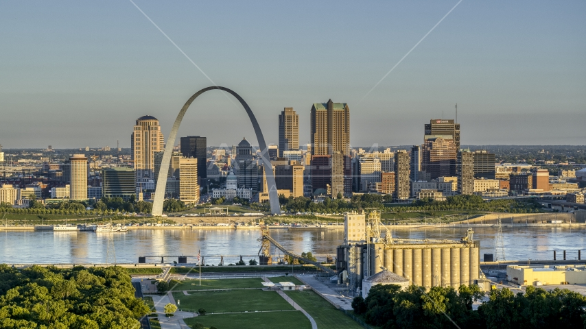 The Arch and city skyline across the Mississippi River at sunrise, Downtown St. Louis, Missouri Aerial Stock Photos | DXP001_021_0001