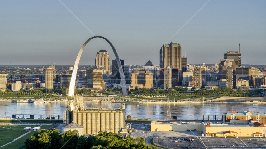 The Arch and skyline, seen from a casino by the Mississippi River, sunrise, Downtown St. Louis, Missouri Aerial Stock Photos | DXP001_021_0002