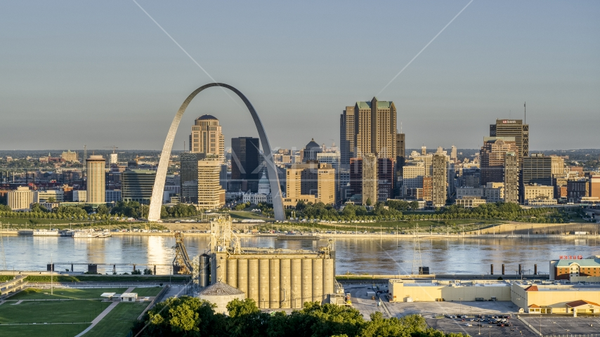 A grain elevator and casino against The Arch and skyline at sunrise, Downtown St. Louis, Missouri Aerial Stock Photos | DXP001_021_0003