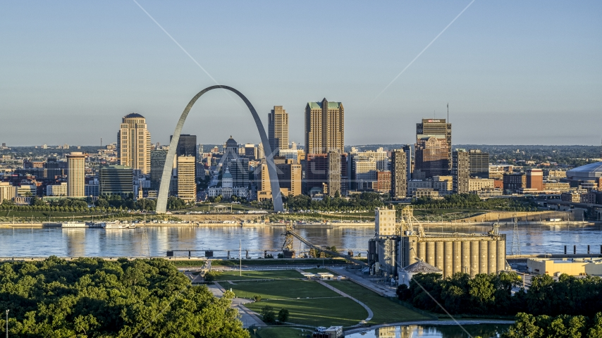The Arch and skyline seen from a park across the Mississippi River, sunrise, Downtown St. Louis, Missouri Aerial Stock Photo DXP001_021_0005 | Axiom Images