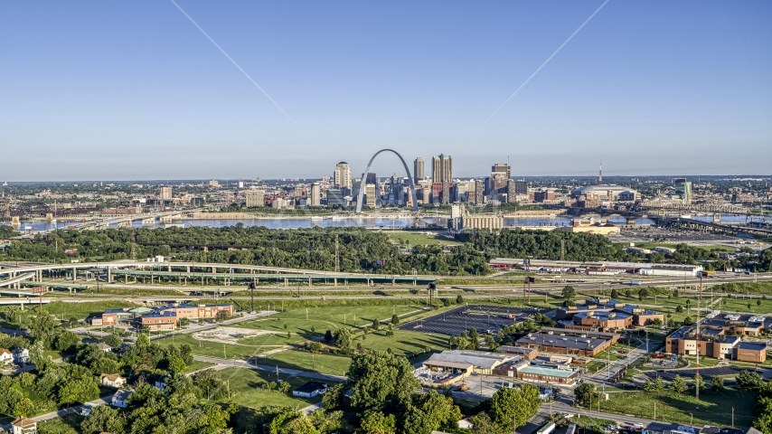 School and interstate in East St. Lous with view of skyline and Arch in Downtown St. Louis, Missouri Aerial Stock Photos | DXP001_022_0006