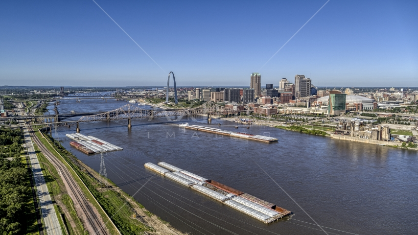 Barges in the river near the Gateway Arch in Downtown St. Louis, Missouri Aerial Stock Photo DXP001_023_0002 | Axiom Images