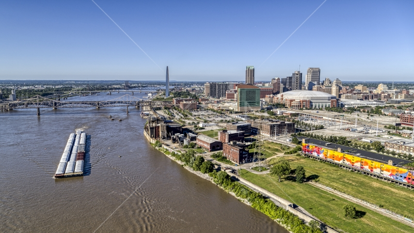 Riverfront buildings and river barge in Downtown St. Louis, Missouri Aerial Stock Photos | DXP001_023_0003