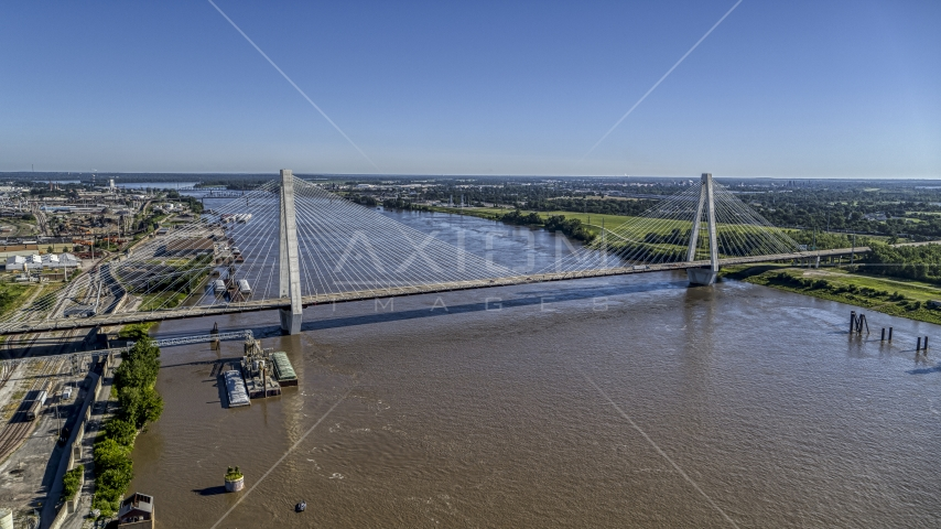 A cable-stayed bridge spanning the Mississippi River revealing barges, St. Louis, Missouri Aerial Stock Photos | DXP001_023_0006