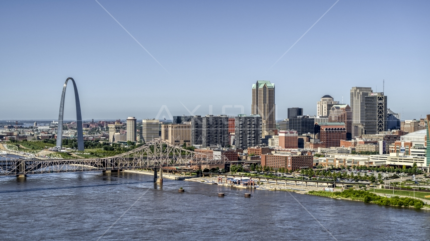 Riverfront office buildings near a bridge with Arch in the background, Downtown St. Louis, Missouri Aerial Stock Photos | DXP001_023_0009