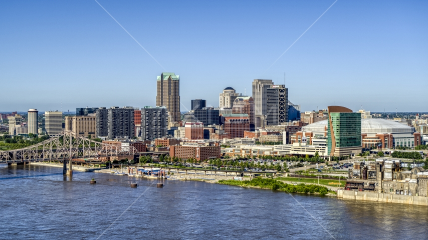 A view of riverfront office buildings near a bridge with Arch in the background, Downtown St. Louis, Missouri Aerial Stock Photos | DXP001_023_0010