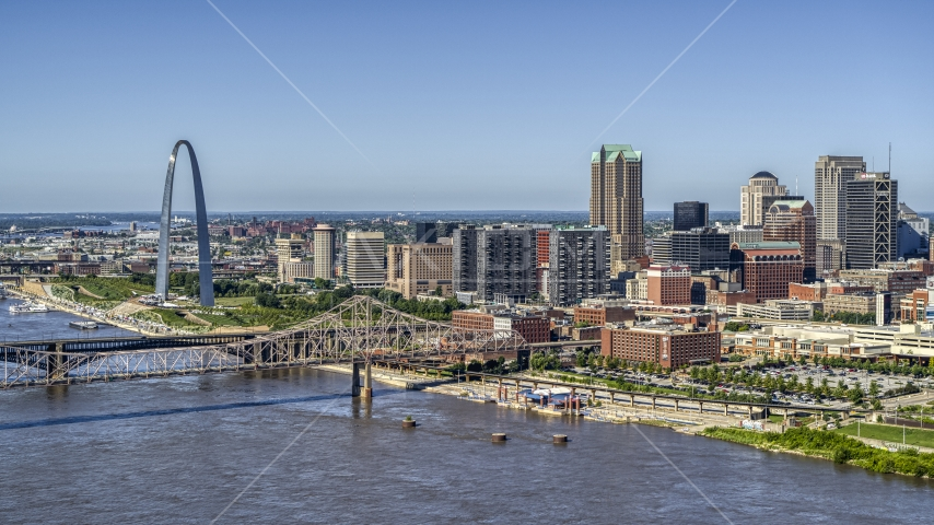 A view of riverfront office buildings near a bridge with Arch in the background, Downtown St. Louis, Missouri Aerial Stock Photos | DXP001_024_0002