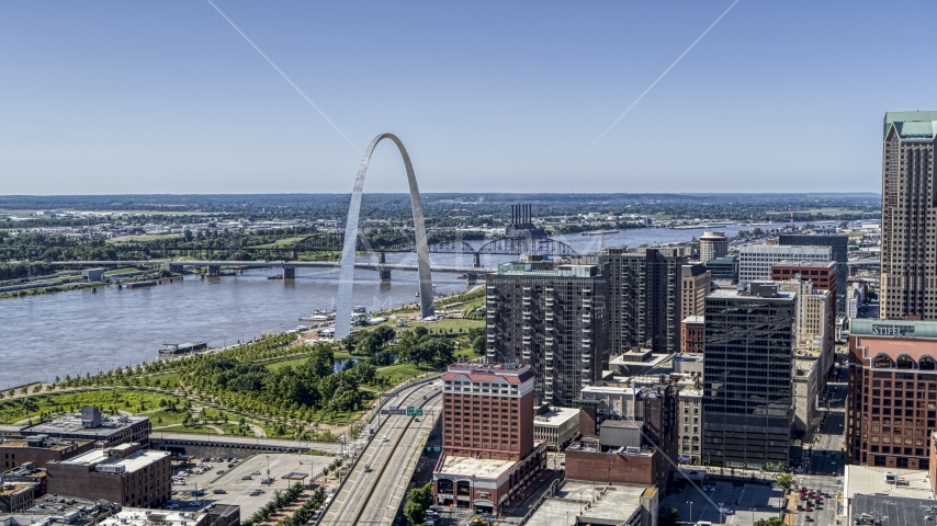 The I-44 between Gateway Arch and office buildings in Downtown St. Louis, Missouri Aerial Stock Photos | DXP001_025_0001