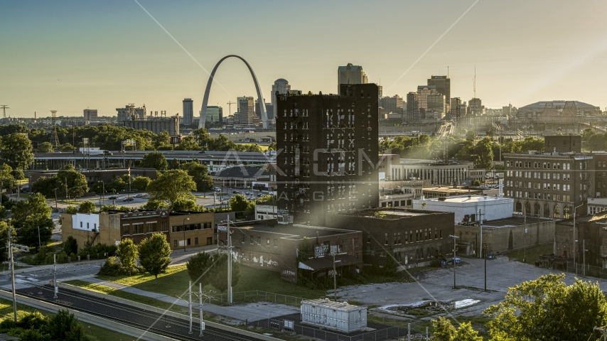 A brick building in East St. Louis, Illinois with the Gateway Arch in background Aerial Stock Photo DXP001_027_0003 | Axiom Images