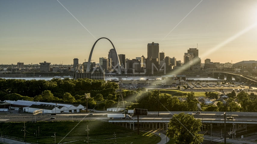 The Gateway Arch and Downtown St. Louis at sunset, seen from East St. Louis, Illinois Aerial Stock Photos | DXP001_027_0004
