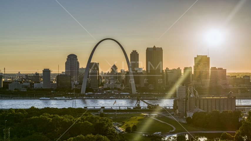 The setting sun behind the Downtown St. Louis, Missouri skyline Aerial Stock Photos | DXP001_028_0001