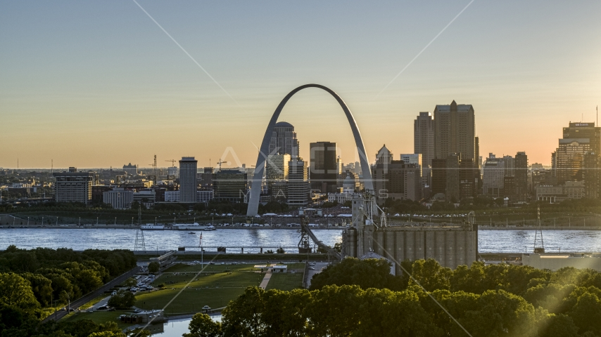 The famous Gateway Arch at sunset in Downtown St. Louis, Missouri Aerial Stock Photos | DXP001_028_0003