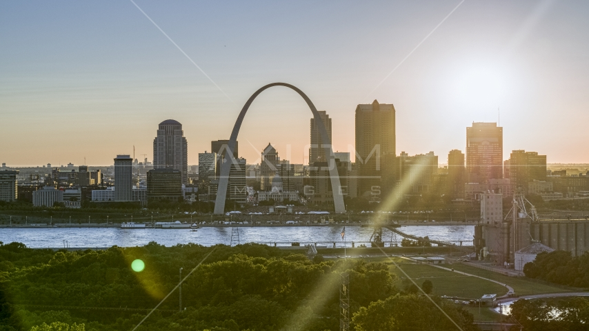 The Arch and Downtown St. Louis, Missouri skyline with setting sun in background Aerial Stock Photos | DXP001_028_0005