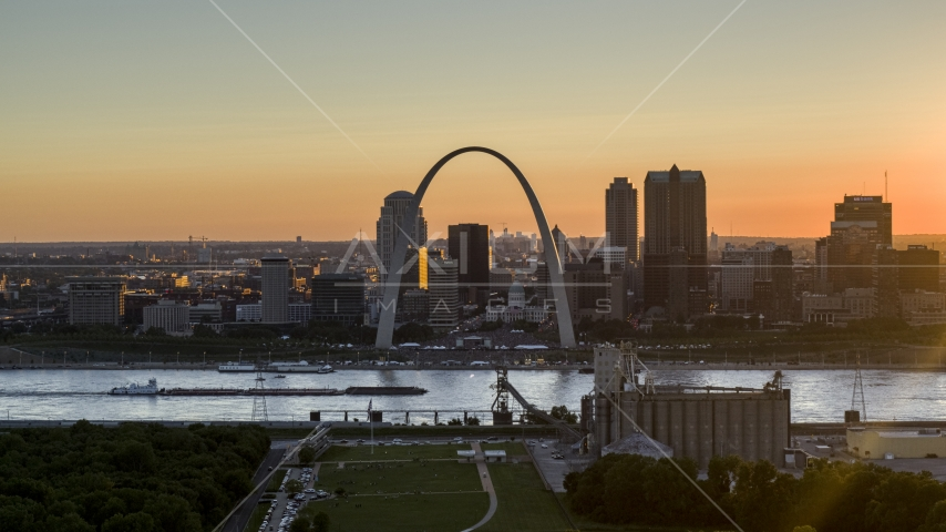 A view of the iconic Gateway Arch and Downtown St. Louis, Missouri at sunset Aerial Stock Photos DXP001_029_0001