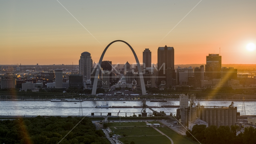 The iconic Gateway Arch and Downtown St. Louis skyline, Missouri at sunset Aerial Stock Photos | DXP001_029_0002