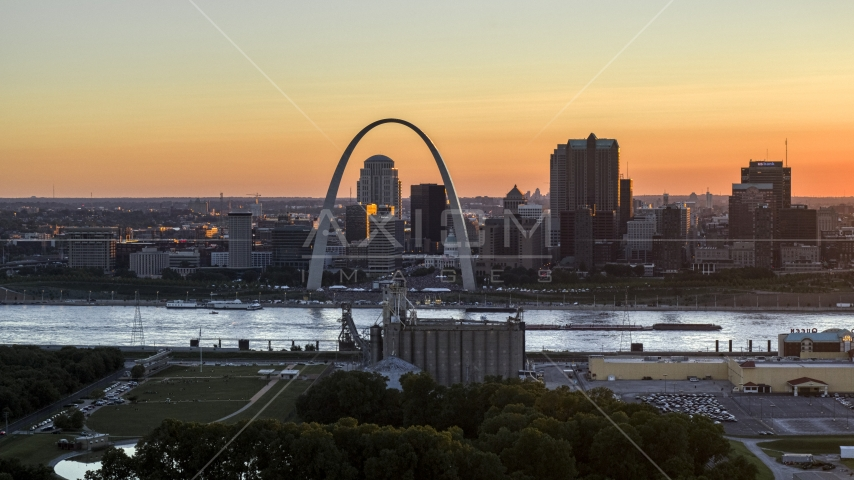 A view across the river of the Gateway Arch and Downtown St. Louis skyline, Missouri at sunset Aerial Stock Photos | DXP001_029_0003