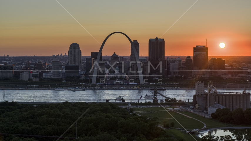 The historic Gateway Arch and Downtown St. Louis skyline, Missouri at sunset Aerial Stock Photos | DXP001_029_0007