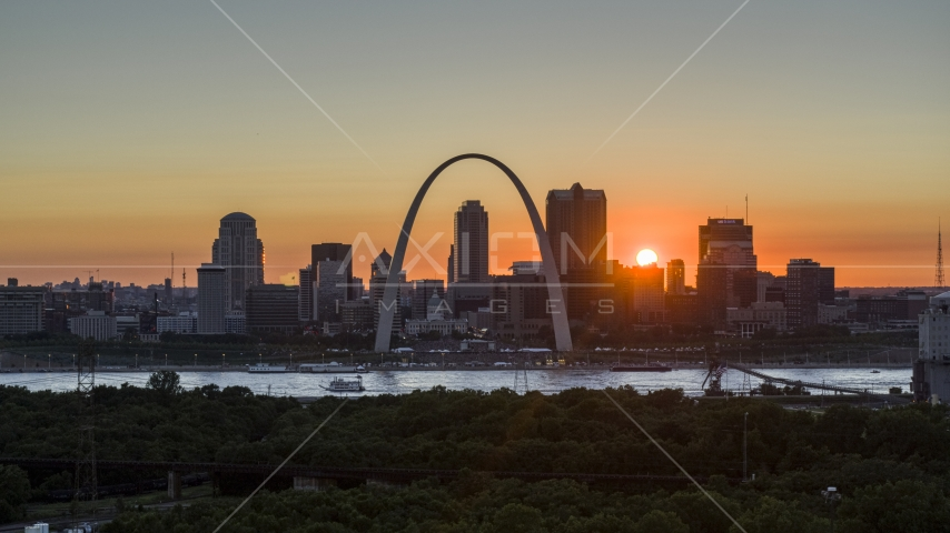 Aerial stock photo of the Gateway Arch and the Downtown St. Louis, Missouri skyline in silhouette at sunset Aerial Stock Photos | DXP001_029_0008