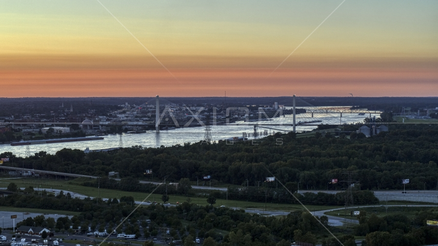The Stan Musial Veterans Memorial Bridge and Mississippi River at sunset in St. Louis, Missouri Aerial Stock Photos | DXP001_029_0009
