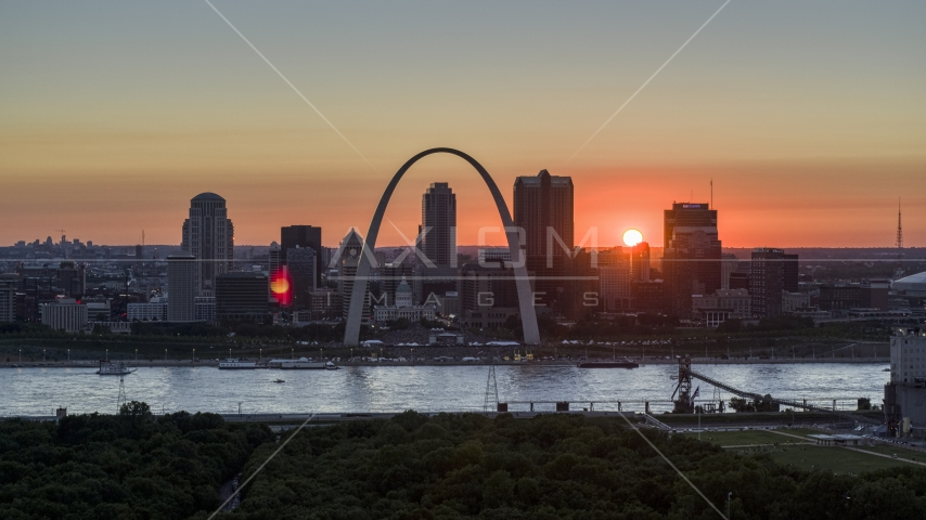 Famous Gateway Arch and the Downtown St. Louis, Missouri skyline in silhouette at sunset Aerial Stock Photos | DXP001_029_0011