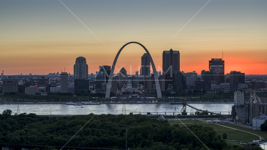 Gateway Arch and Downtown St. Louis, Missouri skyline in silhouette at sunset Aerial Stock Photos | DXP001_029_0012