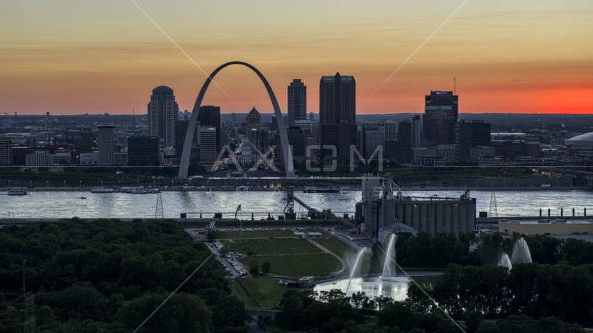 Gateway Arch across the river, seen from grain elevator and fountains, Downtown St. Louis, Missouri, twilight Aerial Stock Photos | DXP001_029_0013