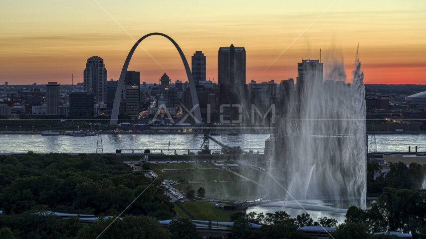 The Gateway Geyser and Arch, Downtown St. Louis, Missouri, twilight Aerial Stock Photos | DXP001_030_0001